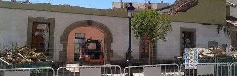 Una calle en remodelaci�n y un edificio por rehabilitar